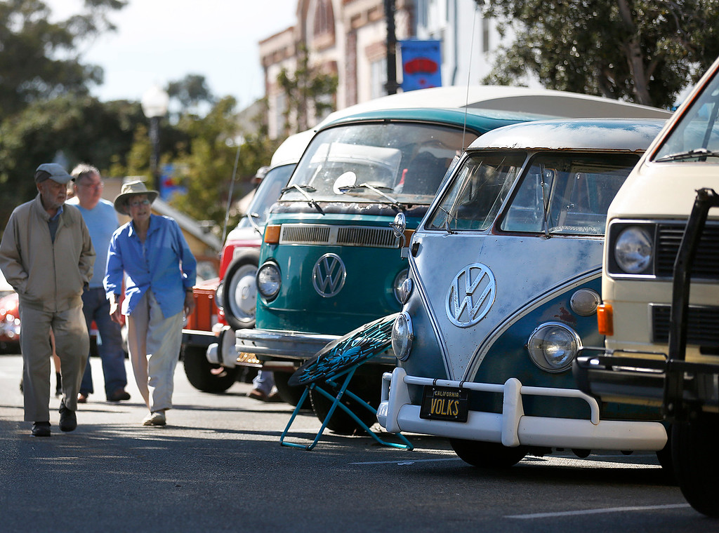 ". A 1966 13 window Volkswagen Van with the license plate ""Volks\"" sits amongst vans from a variety of years during the Treffen 19 VW Cruise Show & Shine in Downtown Pacific Grove, Calif. on Wednesday July 26, 2017. Owner Humberto Munoz of Salinas said police once questioned him if the license plates were real because they were so unique. The 19th Annual cruise from Canada to Mexico stopped in the city attracting local VW affectiandos owners and picked up drivers along the way. (David Royal/Herald Correspondent)"