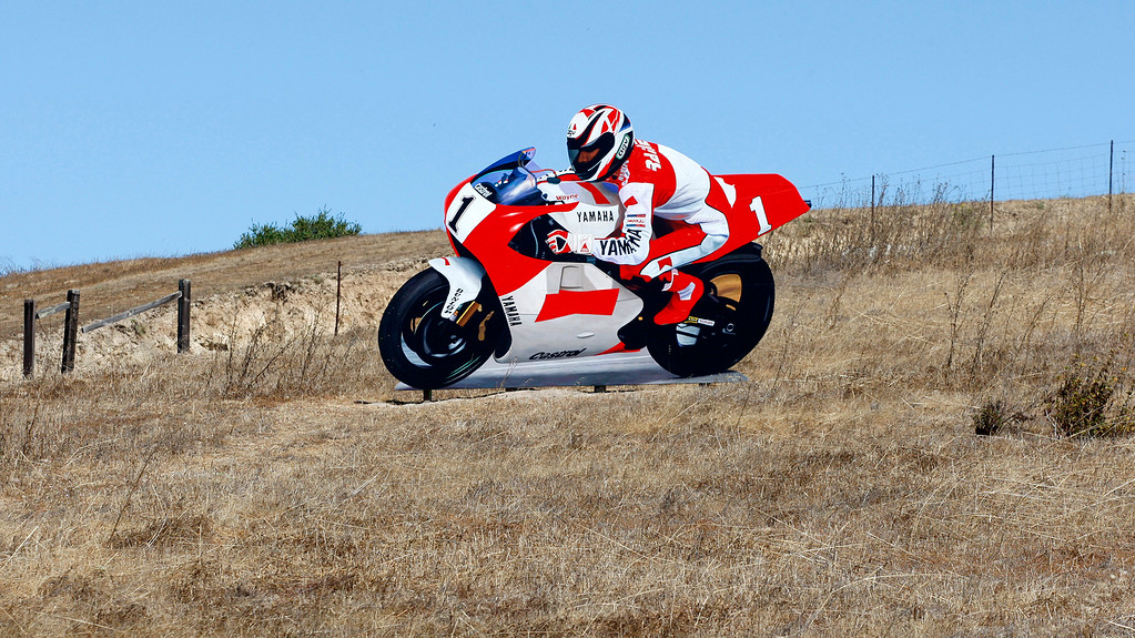 . A mural cutout of famed motorcycle racer Wayne Rainey on hillside in Laguna Seca raceway to celebrate 60th anniversary of track on Tuesday, Aug. 1, 2017.  (Vern Fisher - Monterey Herald)