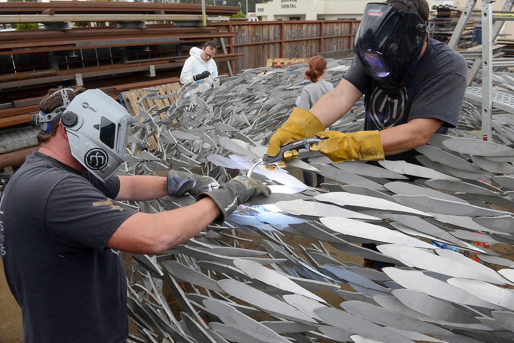 . John Dotto and Sal Espitia at Metal Specialties in Monterey on Thursday, Aug. 3, 2017 as they continue work on the sculpture that will be installed at the new Conference Center plaza fountain in Monterey.  (Vern Fisher - Monterey Herald)