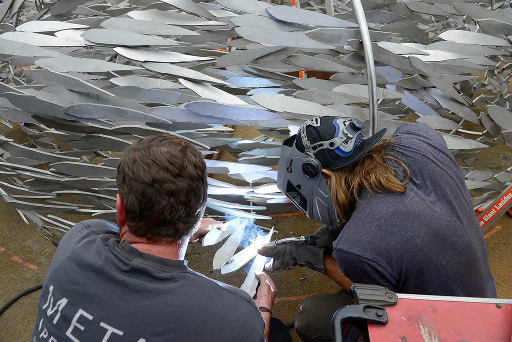 . John Dotto and Matthew Nickells at Metal Specialties in Monterey on Thursday, Aug. 3, 2017 continue work on the sculpture that will be installed at the new Conference Center plaza fountain in Monterey.  (Vern Fisher - Monterey Herald)