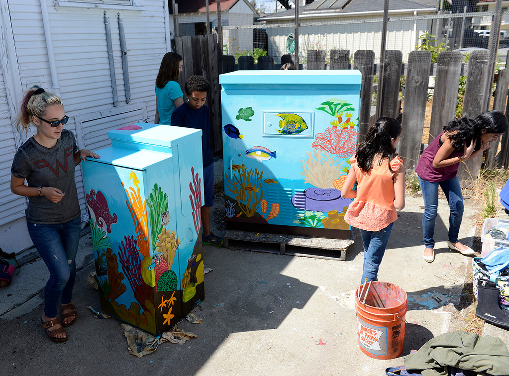. Kids with the Creative Painters Group with their finished utility boxes they painted in Monterey on Aug. 1, 2017.  (Vern Fisher - Monterey Herald)