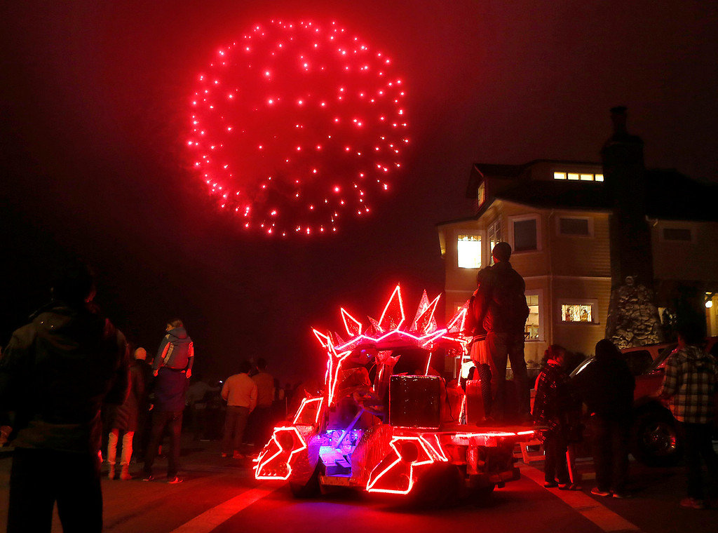. Fireworks explode above the coastline near Lovers Point in Pacific Grove, Calif. marking the end of the Feast of Lanterns performance on Saturday July 29, 2017. Parked below the fireworks is StegaTron art car built by Celsius Maximus of Pacific Grove.  (David Royal/Herald Correspondent)