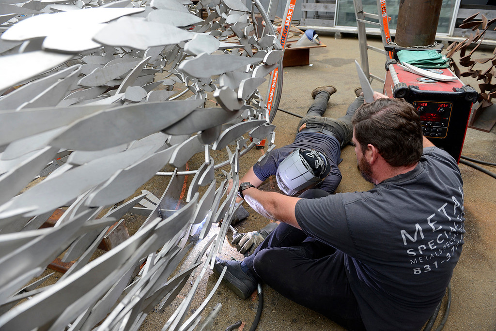 . Matthew Nickells and John Dotto at Metal Specialties in Monterey on Thursday, Aug. 3, 2017 continue work on the sculpture that will be installed at the new Conference Center plaza fountain in Monterey.  (Vern Fisher - Monterey Herald)