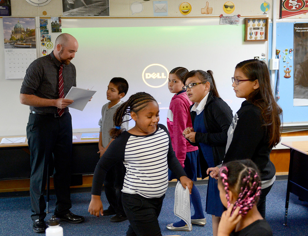 . Marina Vista Elementary School fourth-grade teacher Jacob Gile meets his class on the first day of school at Marina Vista Elementary School in Marina on Wednesday, Aug. 2, 2017.   (Vern Fisher - Monterey Herald)