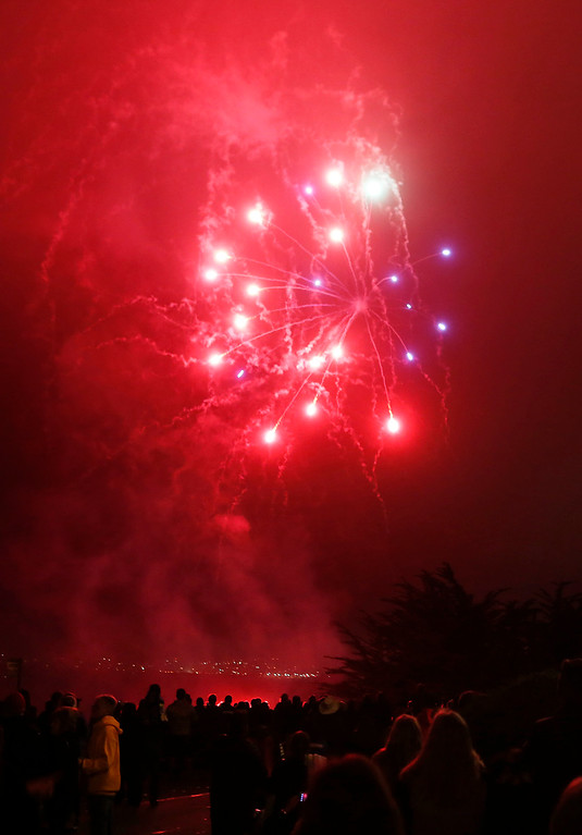 . Fireworks explode above the coastline in Pacific Grove, Calif. marking the end of the Feast of Lanterns performance on Saturday July 29, 2017. (David Royal/Herald Correspondent)