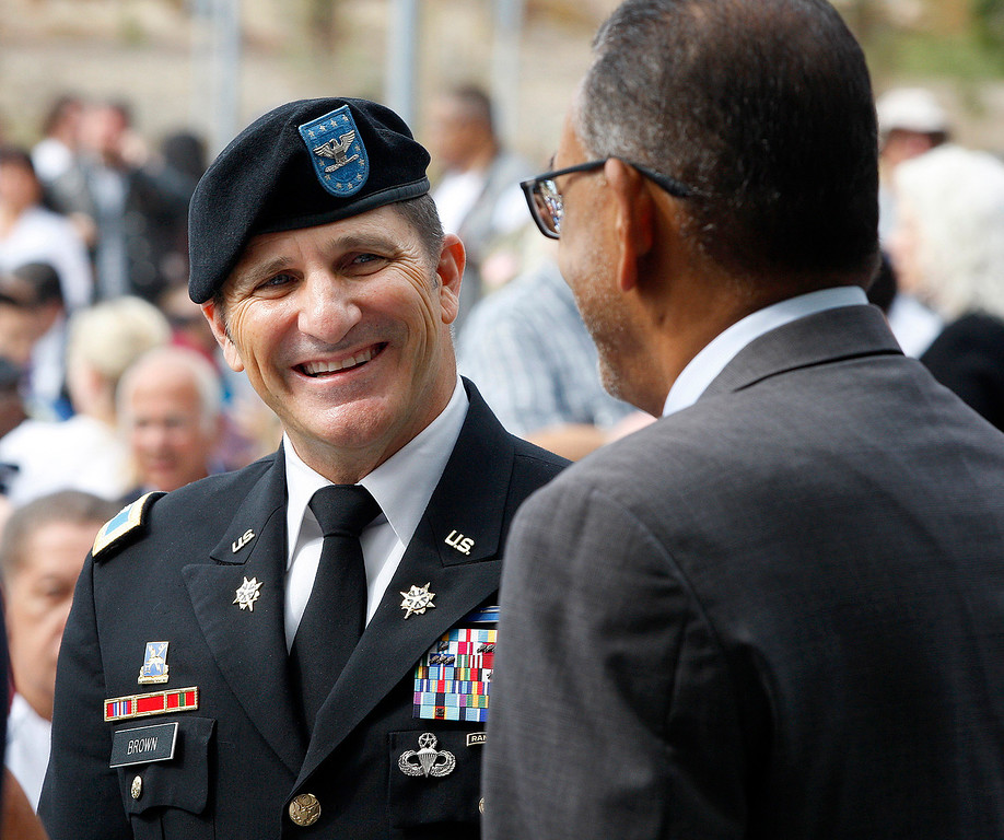 . Colonel Lawrence Brown, garrison commander at the Presidio of Monterey talks with Michael Houlemard, executive officer at FORA during the grand opening ceremony at the Major General William H. Gourley VA-DOD Outpatient Clinic in Marina on Thursday, Aug. 3, 2017.  (Vern Fisher - Monterey Herald)