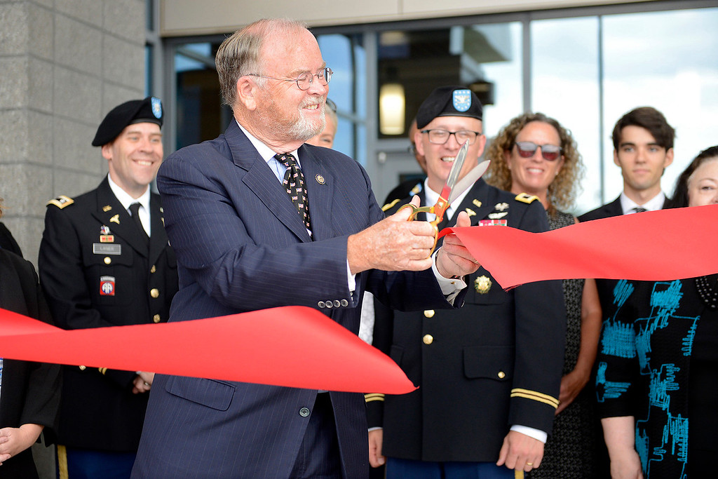 . Former congressman Sam Farr cuts the red ribbon during the grand opening ceremony at the Major General William H. Gourley VA-DOD Outpatient Clinic in Marina on Thursday, Aug. 3, 2017.  (Vern Fisher - Monterey Herald)