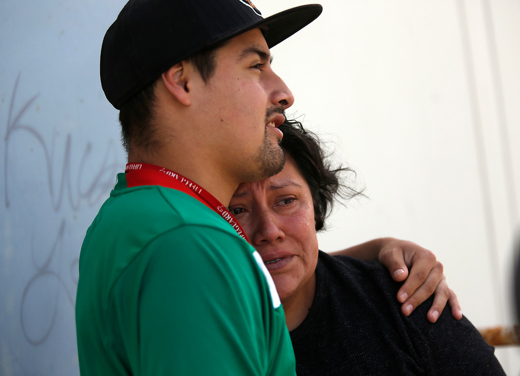 ". Macdonald\'s worker Manny Torres, 19, hugs his crying mother Claudia Lopez Ramirez as firefighters water down the she\'ll of the business on Canyon Del Rey in Seaside on Tuesday June 5, 2018. ""It could have been me me,\"" said Torres of getting caught in the fire. (David Royal/ Herald Correspondent)"