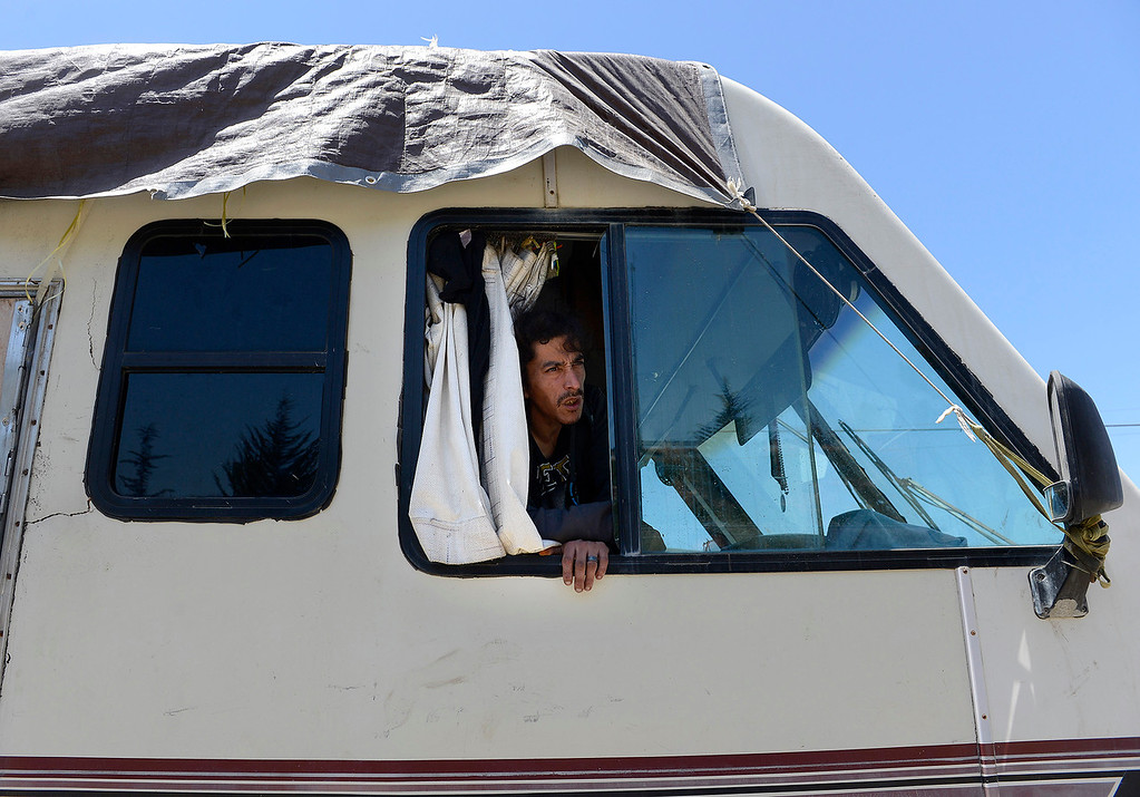 . A occupant in a recreational vehicle parked on Griffin Street in Salinas on Monday, June 4, 2018.  (Vern Fisher - Monterey Herald)