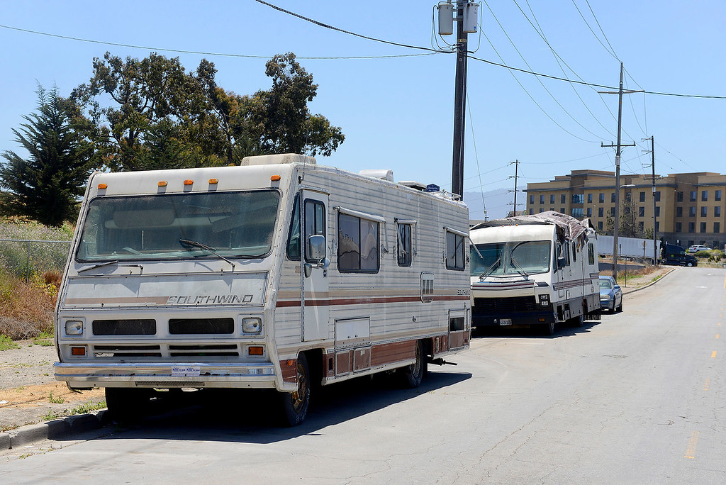 . Recreational vehicles housing homeless people are parked on Griffin Street in Salinas on Monday, June 4, 2018.  (Vern Fisher - Monterey Herald)