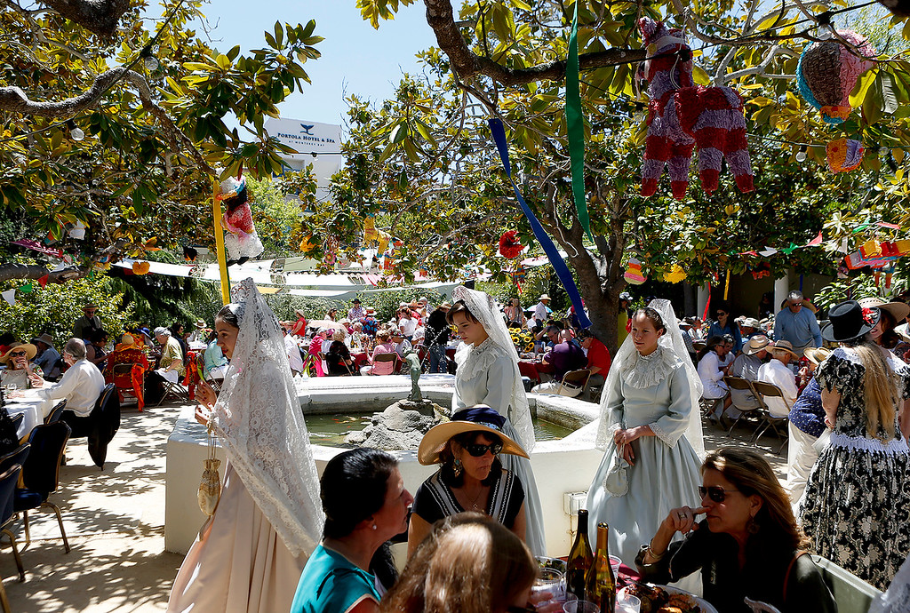 . La Merienda Celebration La favorite Señorita Sakina Munsinger, left, leads La Donecella Señorita Ava Albert and la Doncella Señorita Laura Vetter as they make their rounds inside the Memory Garden at Custom House Plaza in Monterey on Saturday June 2, 2018. (David Royal/ Herald Correspondent)