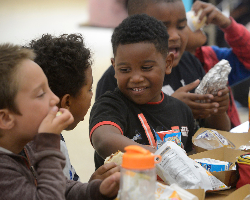 . Gregory Lewis, 5, eats lunch with friends at Crumpton Elementary School in Marina on Tuesday June 6, 2017. MPUSD is serving lunch in the summer so that kids don\'t go hungry. (David Royal - Monterey Herald)