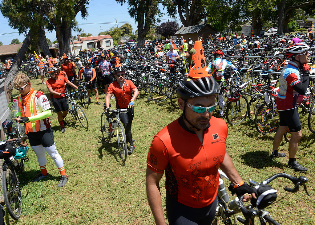 . The Cyclepath team of AIDS/ LifeCycle bicycle riders from Los Angeles arrive with orange cones on their heads for their lunch break in Central Park in Salinas on Monday June 5, 2017. The second leg of the 7-day ride from San Francisco to Los Angeles to raise money for AIDS takes the 2,200 riders on a 109 mile journey from Santa Cruz to King City.  (David Royal - Monterey Herald)