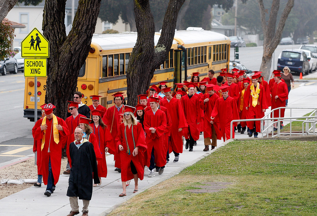 ". Graduating seniors from Pacific Grove High School arrive at Robert Down Elementary School on Friday, June 2, 2017.  The graduates walked the halls of Robert Down school ""high fiving\"" students and former teachers as a way to celebrate their graduation.  (Vern Fisher - Monterey Herald)"
