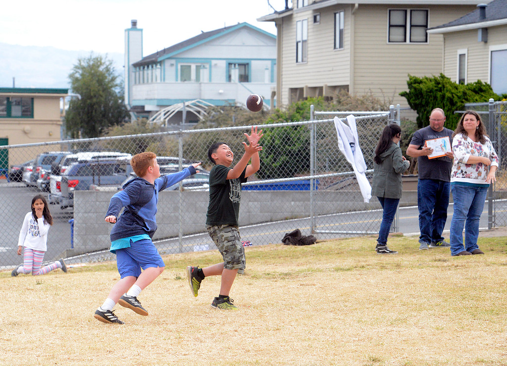 . Aiden Appel reels in a football on the final day of the year at Bay View Academy\'s Upper School in Monterey on Thursday June 8, 2017. (David Royal - Monterey Herald)