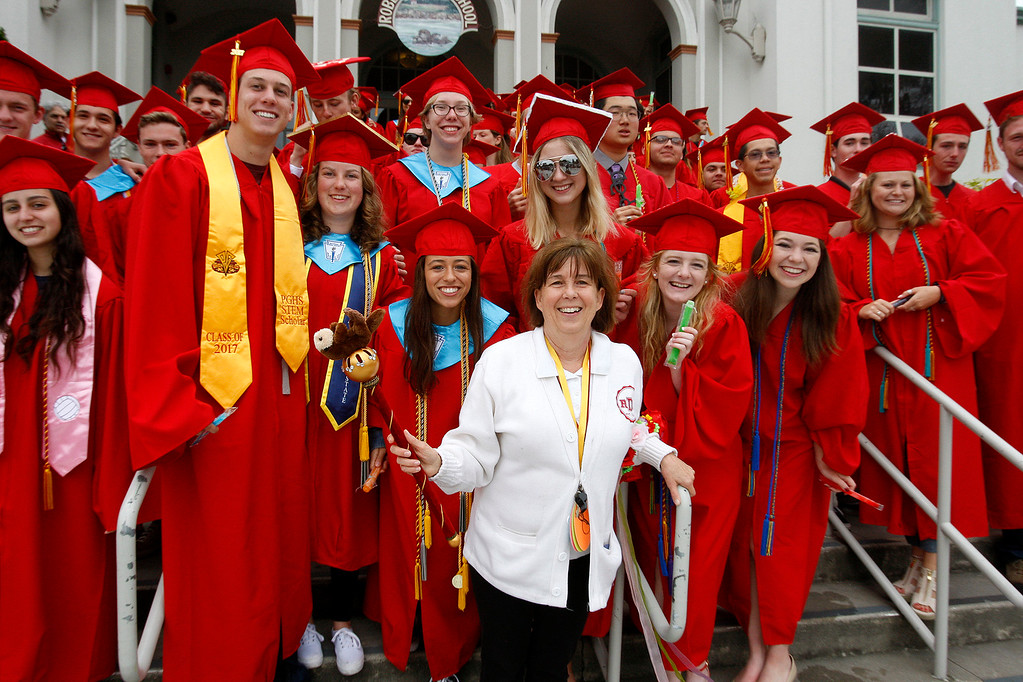 ". Graduating seniors from Pacific Grove High School pose for a group photo with principal Linda Williams at Robert Down Elementary School on Friday, June 2, 2017.  The graduates walked the halls of Robert Down school ""high fiving\"" students and former teachers as a way to celebrate their graduation.  (Vern Fisher - Monterey Herald)"