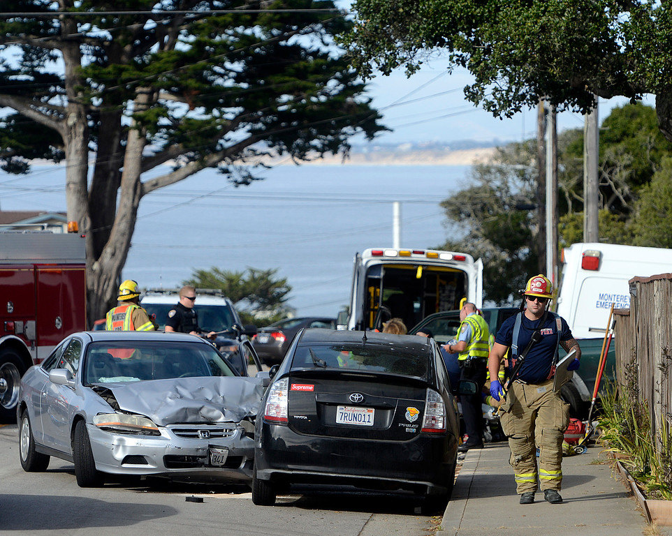 . Emergency crews work the scene of a three car crash on at the corner of David Avenue and Spencer Street in Monterey on Wednesday June 7, 2017. (David Royal - Monterey Herald)