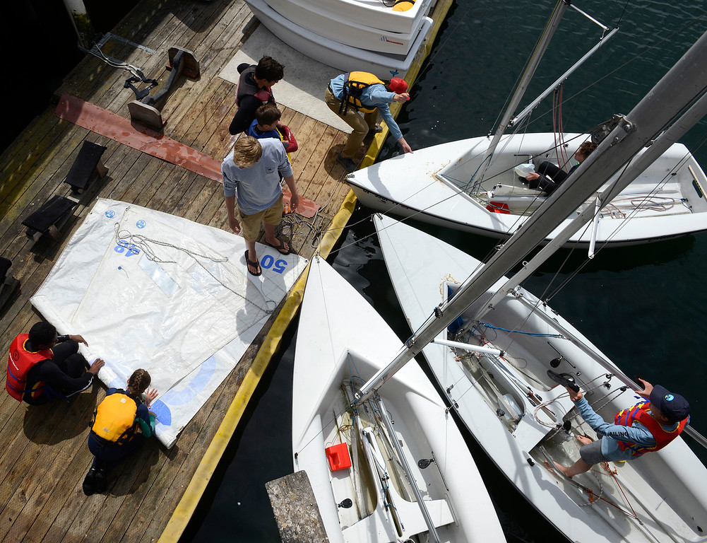 . Young sailors in the Monterey Yacht Club\'s Summer Sailing Camp derig their boats after returning to the Monterey Harbor on Wednesday June 7, 2017. Organizers say there are still openings for the program later in the summer which teaches 8-17 year-olds the fundamentals of sailing. (David Royal - Monterey Herald)