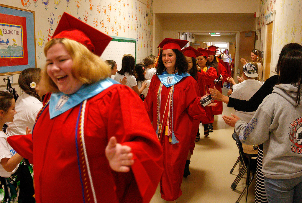 ". Graduating seniors from Pacific Grove High School walk the hallways at Robert Down Elementary School on Friday, June 2, 2017.  The graduates walked the halls of Robert Down school ""high fiving\"" students and former teachers as a way to celebrate their graduation.  (Vern Fisher - Monterey Herald)"