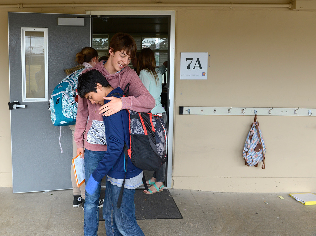 . Graduating eighth grader Eli Gomes hugs seventh grader Isaac Jiminez on the final day of the year at Bay View Academy\'s Upper School in Monterey on Thursday June 8, 2017. (David Royal - Monterey Herald)