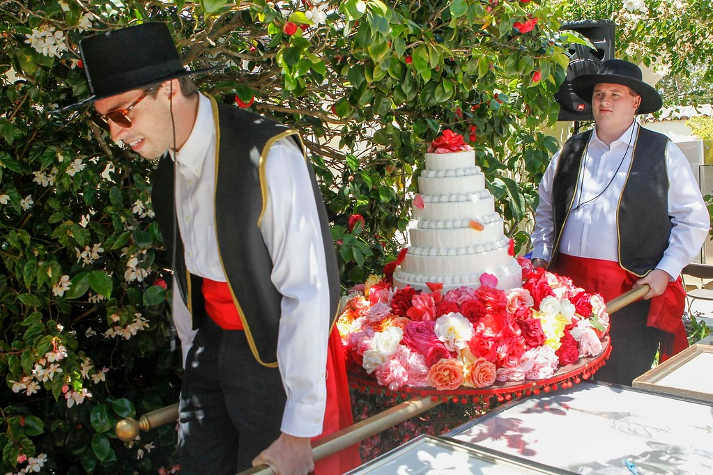 . Spencer Gamble, left, and Andrew Todd parade the cake through the seating area during 2017 La Merienda and the celebration of Montery\'s 247th birthday in the Memory Garden at the Custom House Plaza Saturday, June 3, 2017 in Monterey, Calif. (Vernon McKnight/Herald Correspondent)