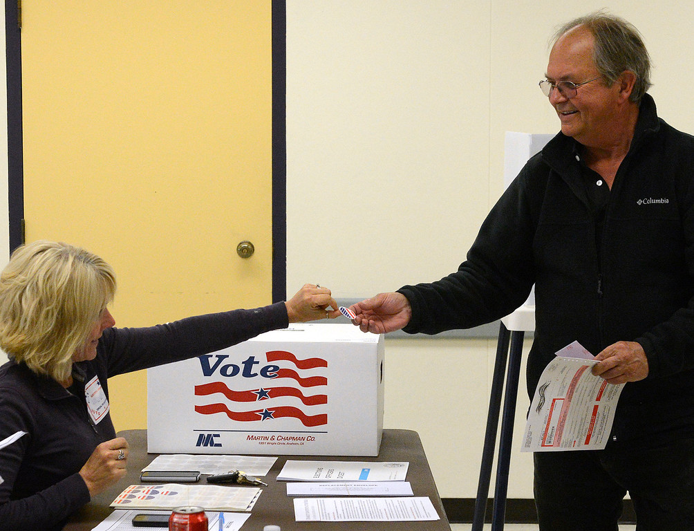 ". Stanley Rogalsky receives a ""I have voted\"" sticker from Seaside Police commander Julie Veloz after placing his ballot into a box at the Oldemeyer Center polling site in Seaside on Tuesday June 6, 2017. Special election ballots were cast on Tuesday for Measure L, an 1/2 cent sales tax increase to cover emergency and other general services and Measure G which would place a 10% tax on marijuana businesses.  (David Royal - Monterey Herald)"