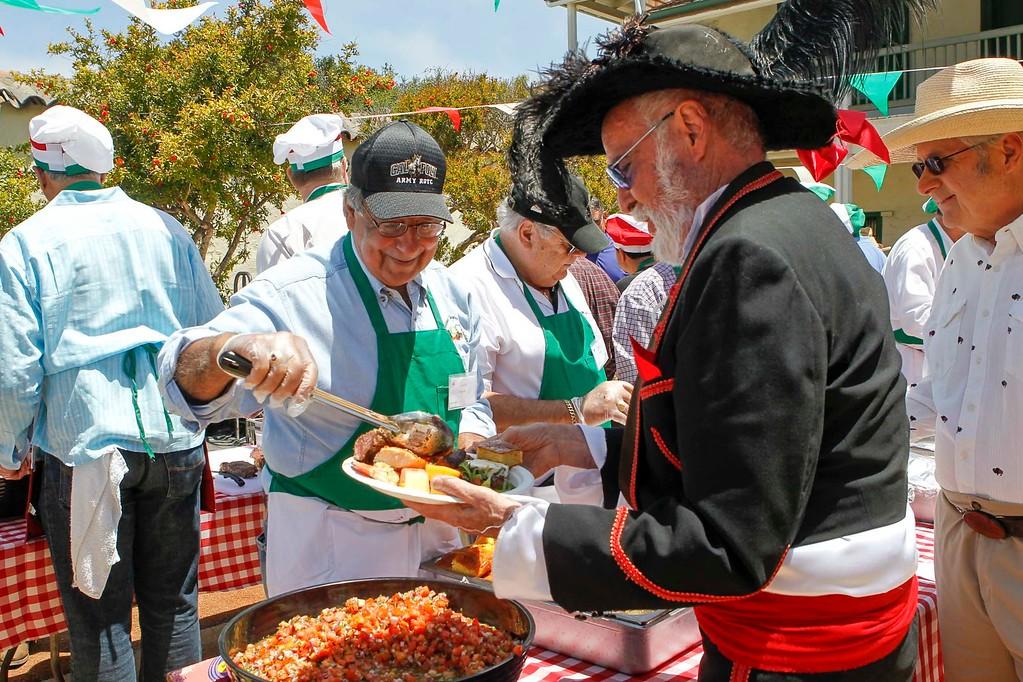 . Leon E. Panetta serves fresh salsa during 2017 La Merienda and the celebration of Montery\'s 247th birthday in the Memory Garden at the Custom House Plaza Saturday, June 3, 2017 in Monterey, Calif. (Vernon McKnight/Herald Correspondent)