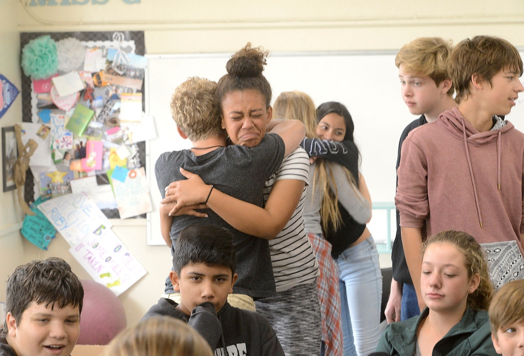 . Lyrik Hampshire, center, hugs a classmate as members of the eighth grade class say goodbye to each other on the final day of the year at Bay View Academy\'s Upper School in Monterey on Thursday June 8, 2017. (David Royal - Monterey Herald)