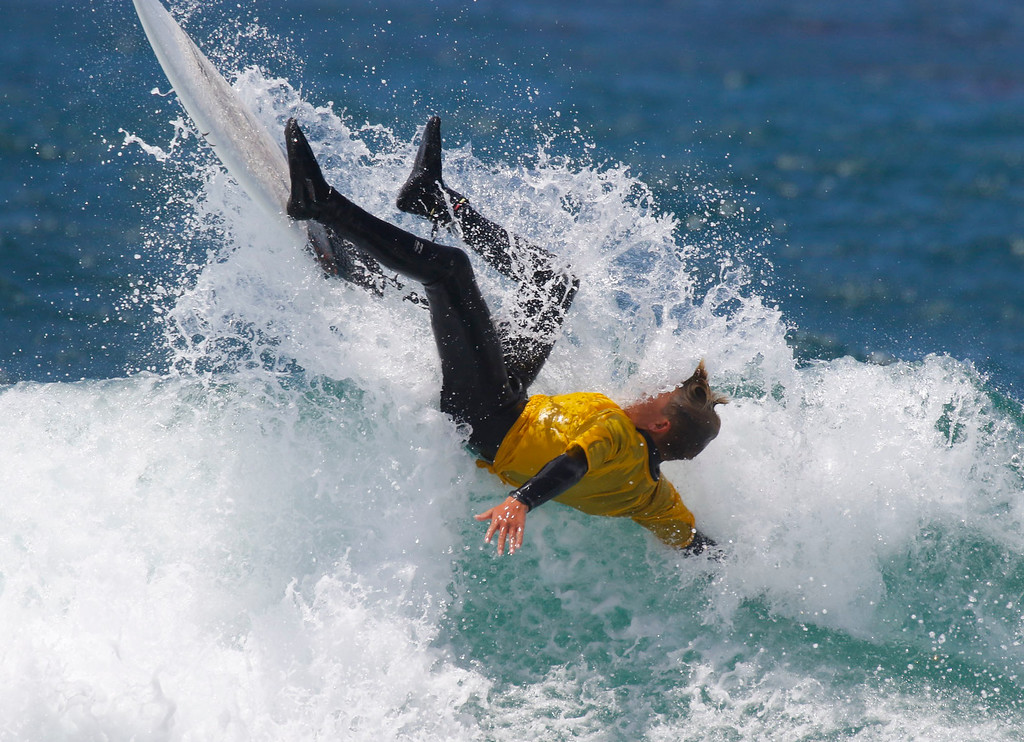 . Dayson Keller falls of his surfboard as while competing in the Junior Finals during the 37th annual Sunshine Freestyle Surfabout at Carmel Beach on Sunday, June 4, 2017 in Carmel By The Sea, Calif. (Vernon McKnight/Herald Correspondent)