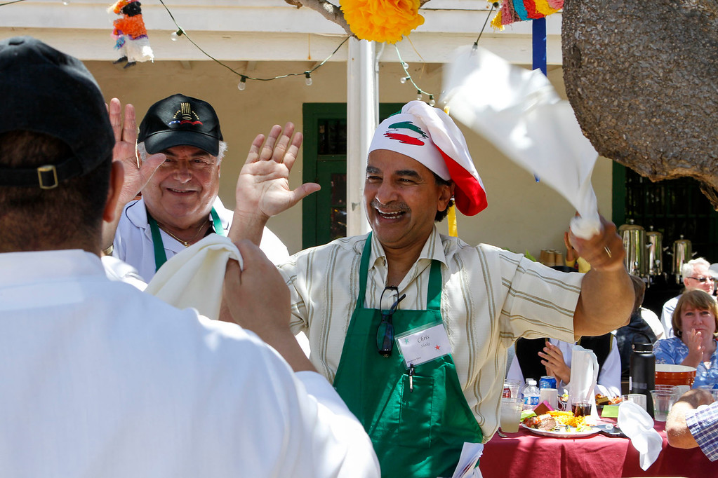 . Chris Shake swings a towel as he leads a parade of volunteer cooks around during 2017 La Merienda and the celebration of Montery\'s 247th birthday in the Memory Garden at the Custom House Plaza Saturday, June 3, 2017 in Monterey, Calif. (Vernon McKnight/Herald Correspondent)