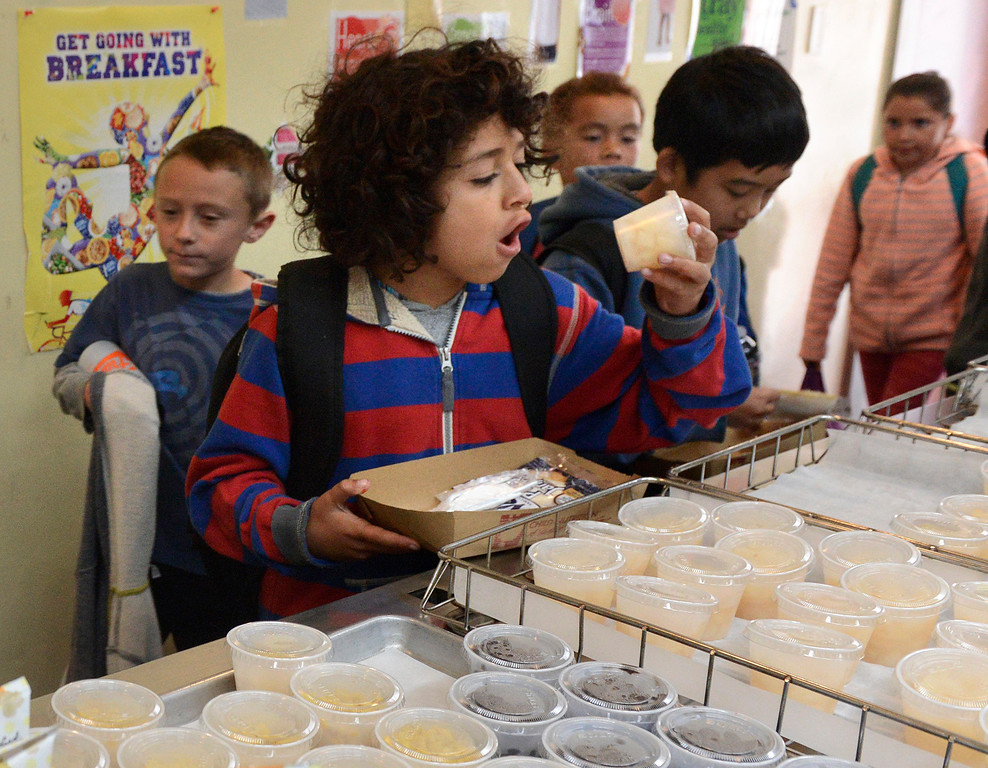 . Giovanny Gallo, 10, checks out fruit cup full of diced pears as students  get their lunches at Crumpton Elementary School in Marina on Tuesday June 6, 2017. MPUSD is serving lunch in the summer so that kids don\'t go hungry. (David Royal - Monterey Herald)
