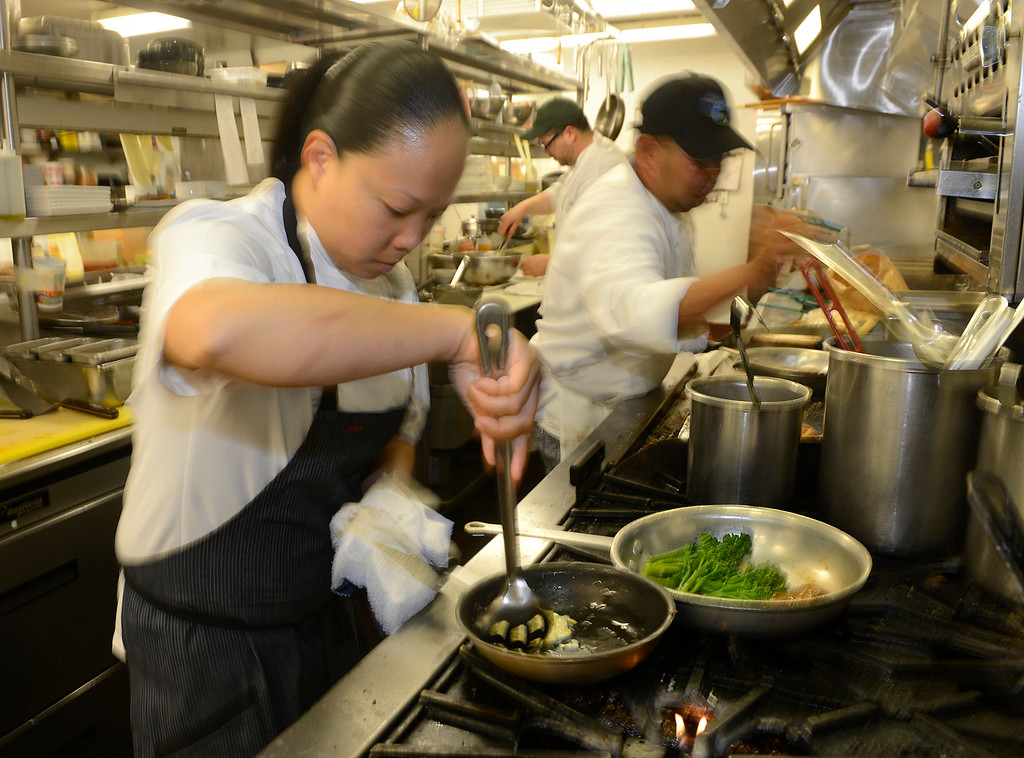 . Chef Anna Marie Bayonito works in the kitchen at Sticks Restaurant at The Inn at Spanish Bay in Pebble Beach on Monday June 5, 2017.  (David Royal - Monterey Herald)