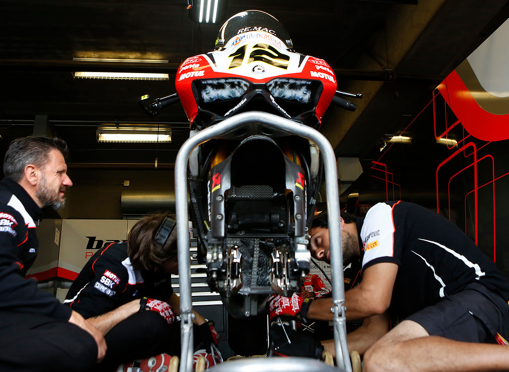 . Barni Racing Team mechanics go to work on Xavi Flores\' Ducati during the Superbike World Championship at Laguna Seca Raceway in Monterey on Sunday June 24, 2018.   (David Royal/ Herald Correspondent)