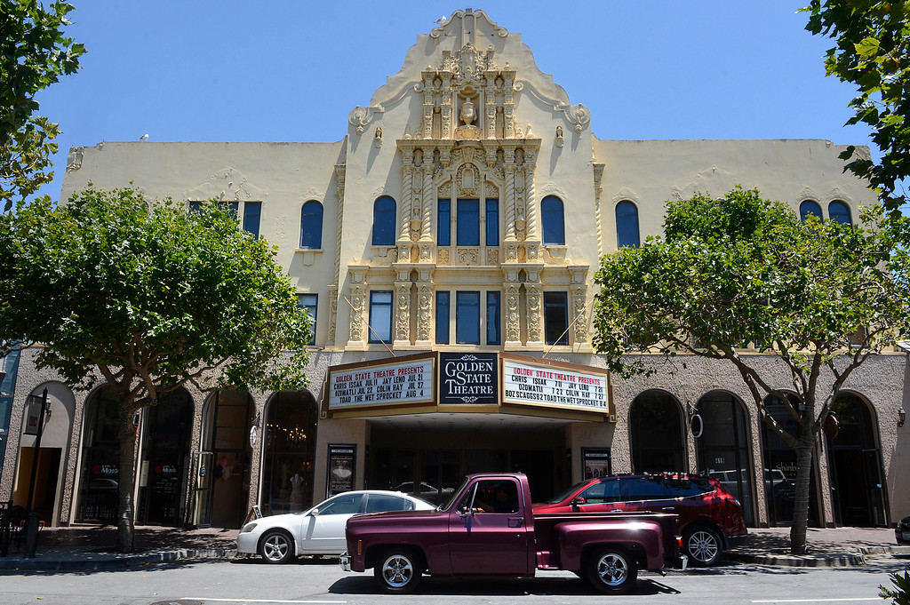 . A truck passes the historic Golden State Theater in Downtown Monterey on Friday June 23, 2017. The remodeled third floor of the theater will be offered as a rental space along with several offices on the second floor. (David Royal - Monterey Herald)