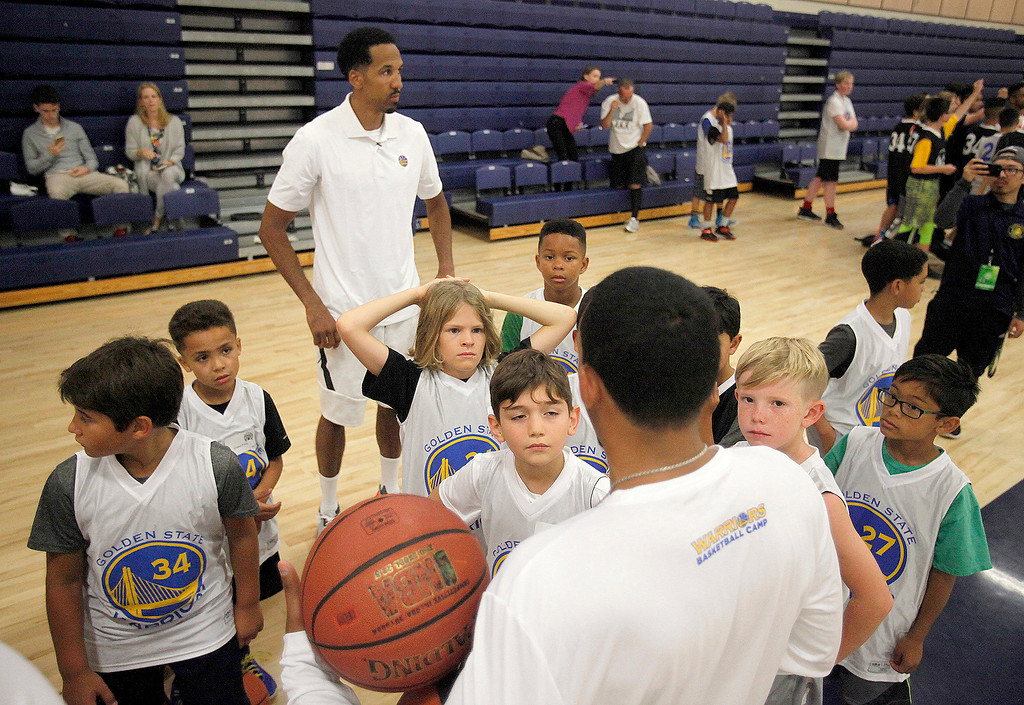 . Shaul Livingston with participants at the Warriors overnight camp featuring current Warriors players Zaza Pachulia and Shaun Livingston at CSU Monterey Bay on Thursday, June 29, 2017.  (Vern Fisher - Monterey Herald)