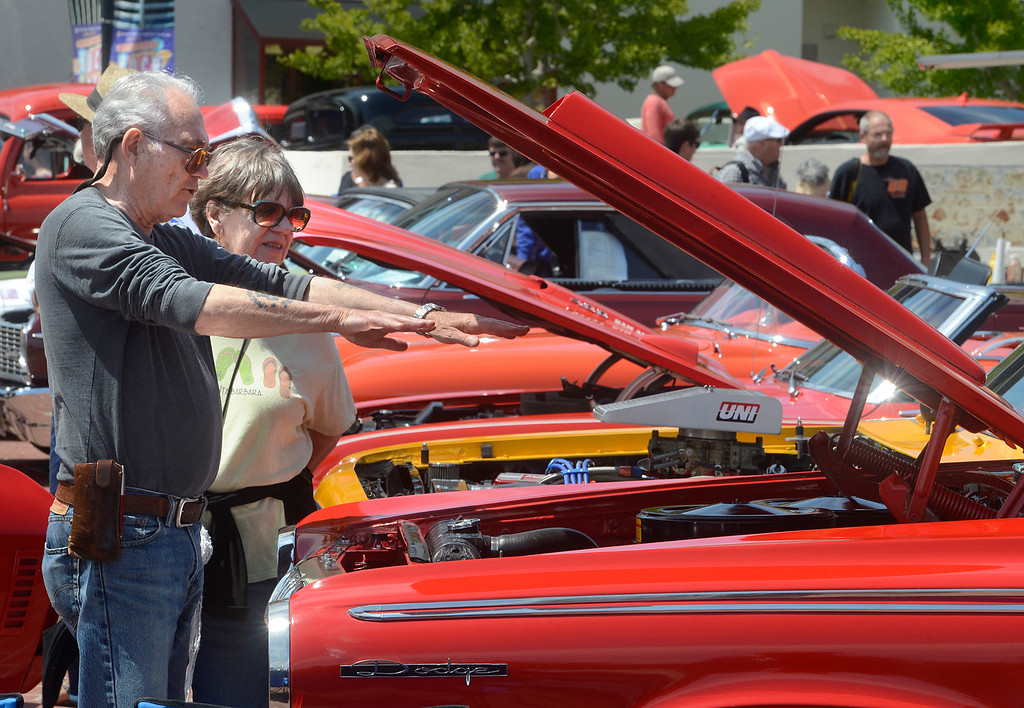 . Dave Thompson and his wife Bev of the East Garrison look over the engine of a 1963 Dodge 440 during the Monterey Rock & Rod car show at Custom House Plaza in Monterey on Saturday June 24, 2017. (David Royal - Monterey Herald)
