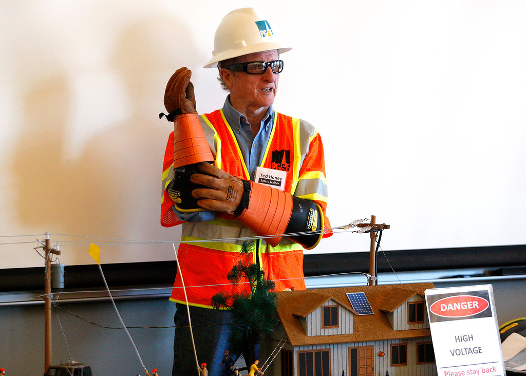 . Retired PG&E training supervisor Ted Honey discusses electrical safety rules at the Monterey Peninsula College Public Safety Training Center in Seaside on Monday, June 26, 2017.   (Vern Fisher - Monterey Herald)