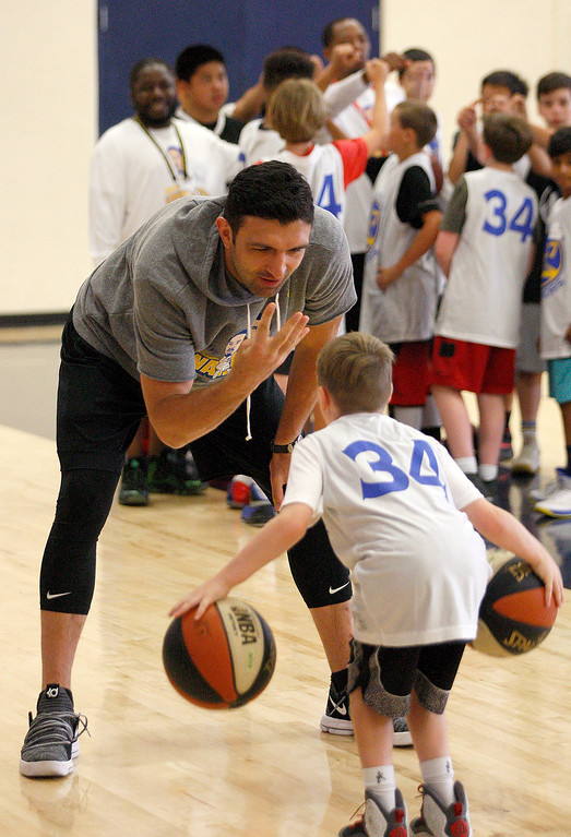 . Zaza Pachulia works with David Carter, 9, at the Warriors overnight camp featuring current Warriors players Zaza Pachulia and Shaun Livingston at CSU Monterey Bay on Thursday, June 29, 2017.  (Vern Fisher - Monterey Herald)
