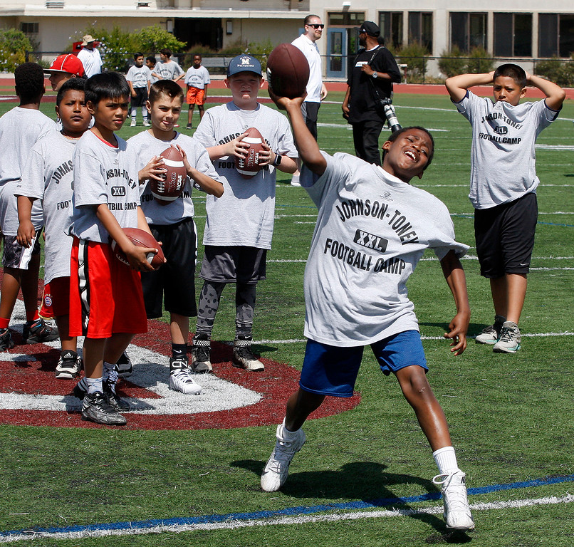 . Julius Tharpe, 10, attempts a pass at the Johnson-Toney football camp at Monterey Peninsula College in Monterey on Tuesday, June 27, 2017.  (Vern Fisher - Monterey Herald)
