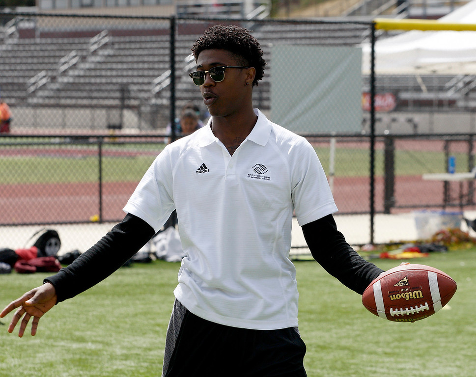 . Chris Evans the former Seaside High multi-sport standout helps out at the Johnson-Toney football camp at Monterey Peninsula College in Monterey on Tuesday, June 27, 2017.  (Vern Fisher - Monterey Herald)