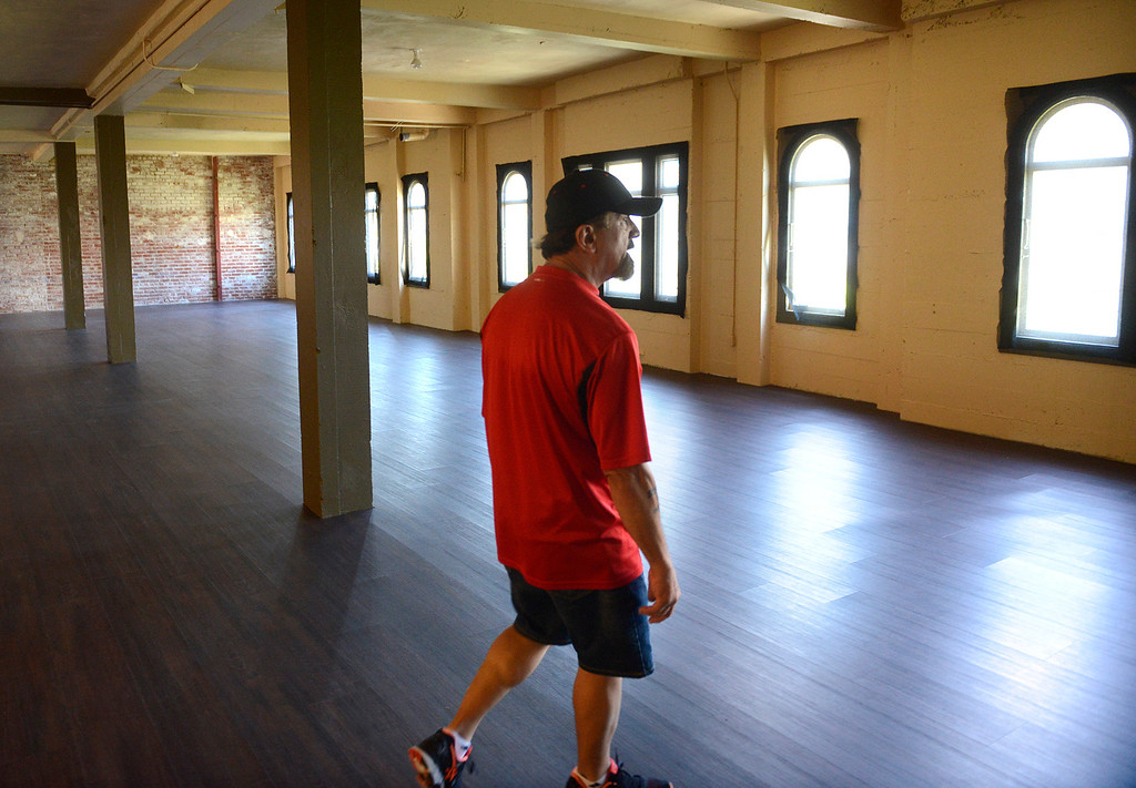 . Golden State Theater facility aid Ronald Guth walks through newly renovated rental space on the third floor of the historic building in Downtown Monterey on Friday June 23, 2017. (David Royal - Monterey Herald)