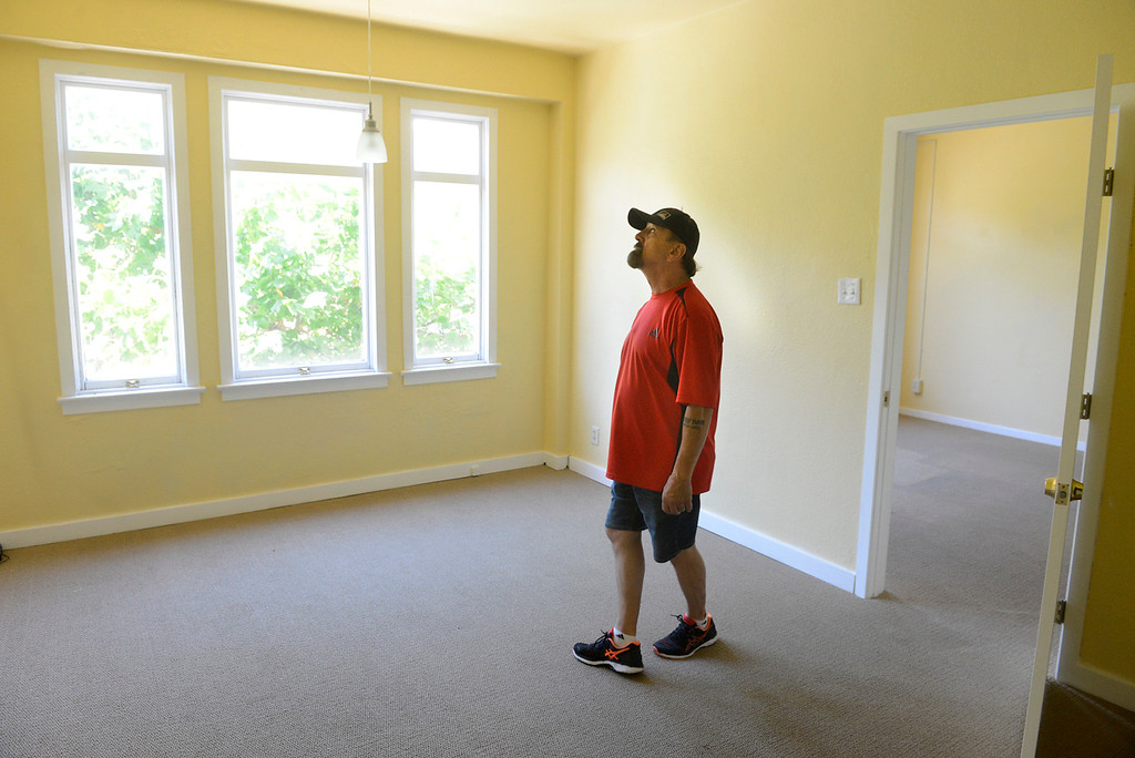 . Golden State Theater facility aid Ronald Guth walks through a new office rental space on the second floor of the historic building in Downtown Monterey on Friday June 23, 2017. (David Royal - Monterey Herald)