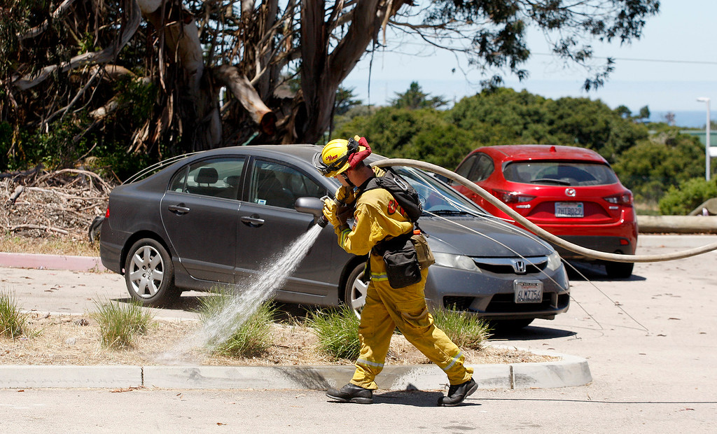 . Cal Fire personnel demonstrated a mobile hose fast attack at the Monterey Peninsula College Public Safety Training Center in Seaside on Monday, June 26, 2017.   (Vern Fisher - Monterey Herald)