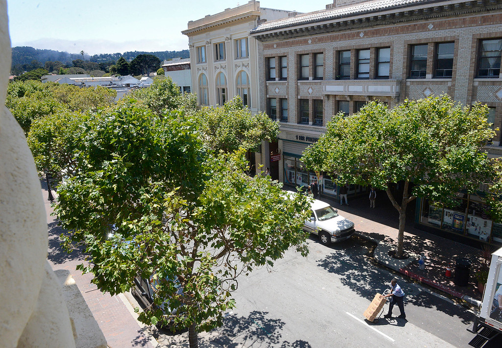 . A man makes a delivery on Alvarado Street in this view from the new rental space on the third floor of the historic Golden State Theater in Downtown Monterey on Friday June 23, 2017. (David Royal - Monterey Herald)