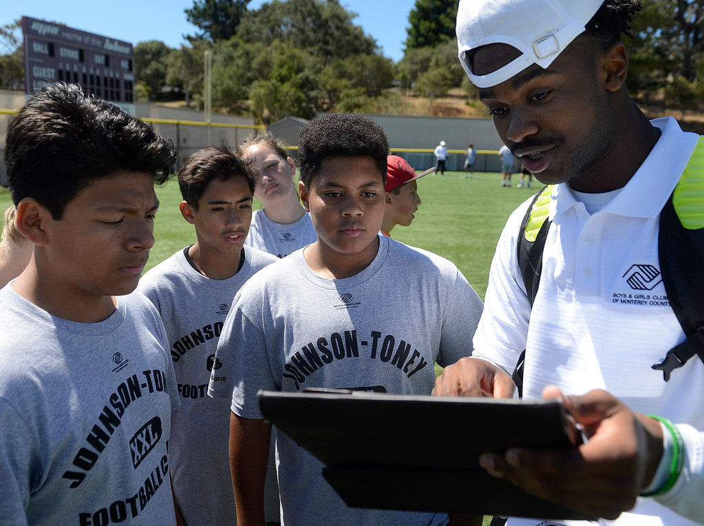. Wes Johnson works with his team of 12-14 year-olds while scrimmaging during the Johnson-Toney Football Camp at Monterey Peninsula College on Monday June 26, 2017. (David Royal - Monterey Herald)