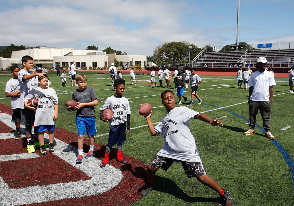 . Javance Coleman, 9, attempts a pass at the Johnson-Toney football camp at Monterey Peninsula College in Monterey on Tuesday, June 27, 2017.  (Vern Fisher - Monterey Herald)
