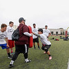 Terry Poole, far right, watches campers participate in lineman drills during the Ron Johnson-Anthony Toney Football Camp at Monterey Peninsula College on Wednesday, June 29, 2016 in Monterey, Calif. (Photo by Vernon McKnight)