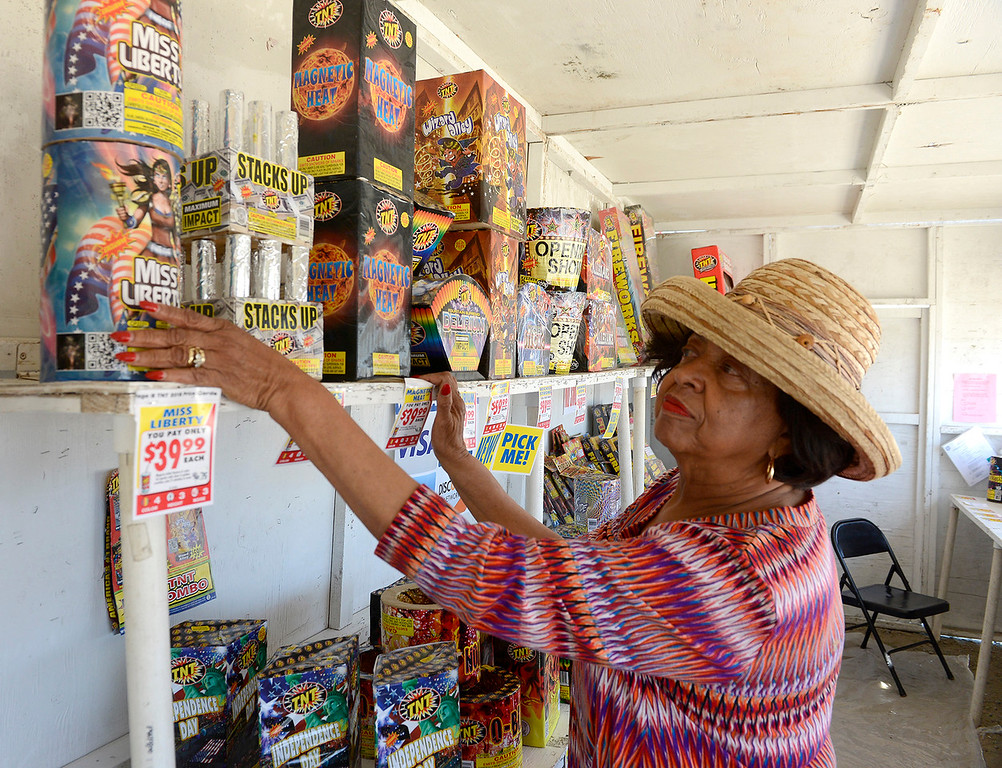 . Alice Jordan selling Safe and Sane fireworks in Seaside on Friday, June 29, 2018.  (Vern Fisher - Monterey Herald)