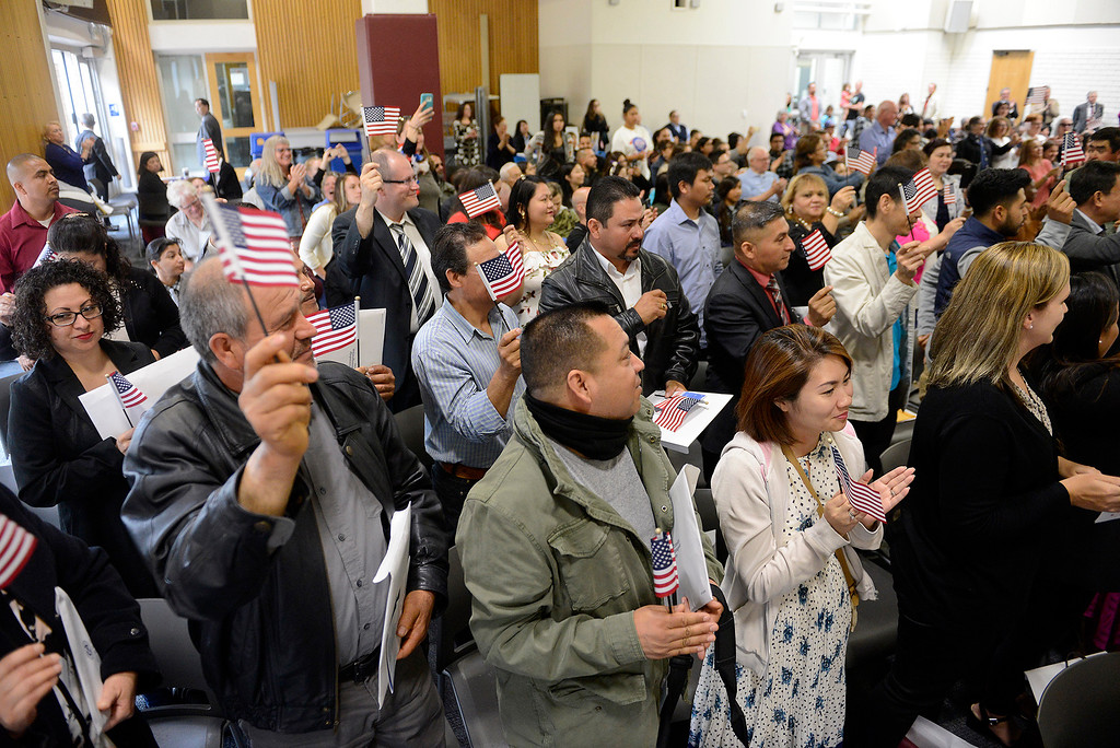 . Seventy-eight new U.S. citizens celebrate after taking the oath of allegiance at the Independence Day Naturalization Ceremony at Hartnell College in Salinas on Tuesday, July 3, 2018.  (Vern Fisher - Monterey Herald)