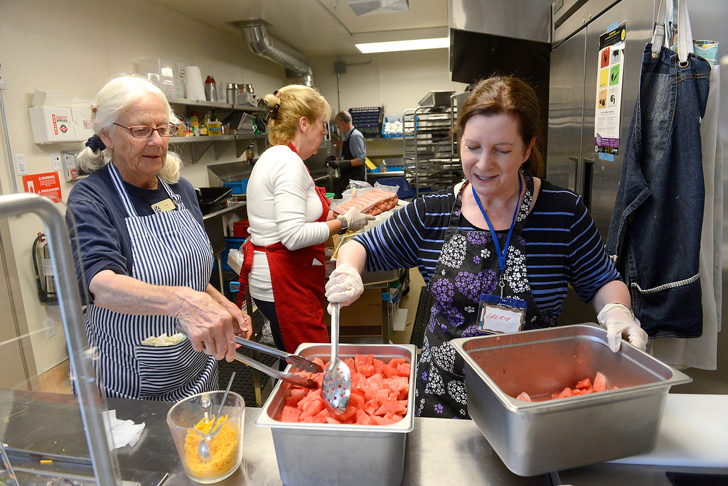 . Volunteers Susie Harris, Susan Lerable and Laurie Baum serve meals to women at the non-profit Gathering for Women in Monterey on Tuesday, July 3, 2018.  The Gathering for Women has opened its permanent day center in Monterey, a $2.5 million project that now has a paid staff and includes both health and transitional programming along with serving breakfast and lunch every day to the women it serves.  (Vern Fisher - Monterey Herald)